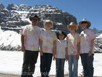 Family by snow in Banff National Park